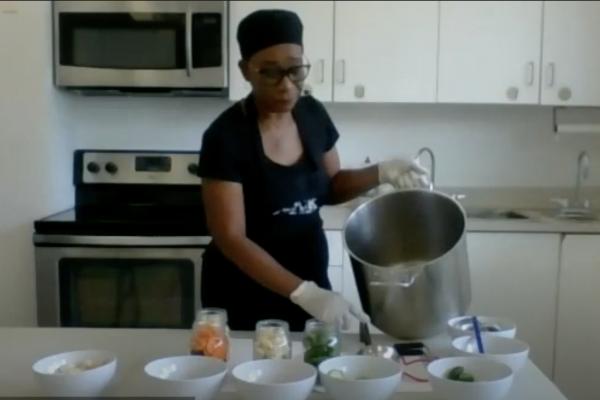 Angela, Urban Harvest Community leader cooking in kitchen